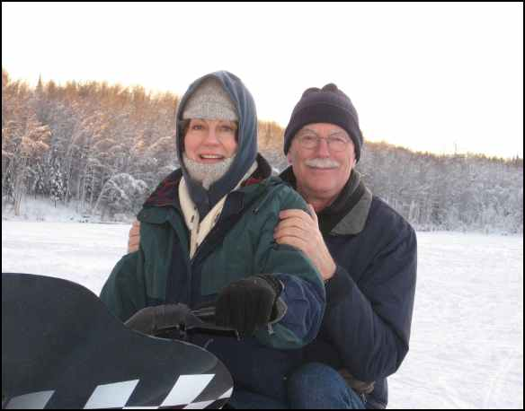 Jim and Mickey Feeney Snowmachining in Alaska